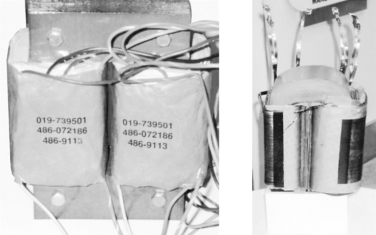 Two transformer core and coil assemblies.