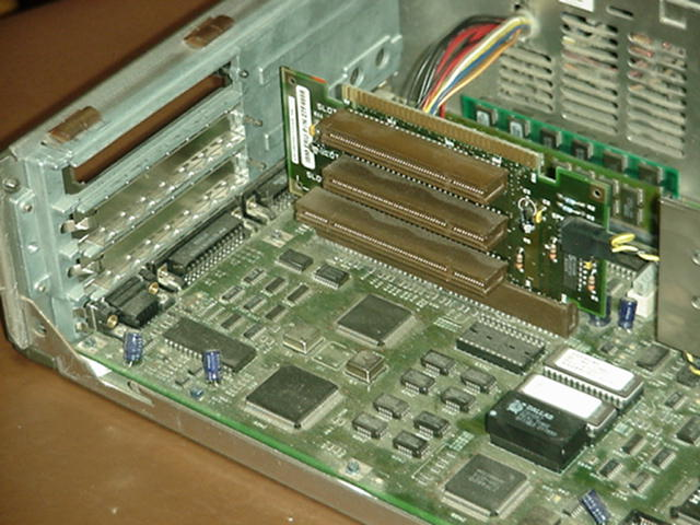 Multiple slot riser seated in a motherboard